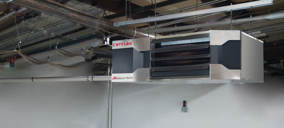 Optum unit heater hanging from the ceiling in a workshop