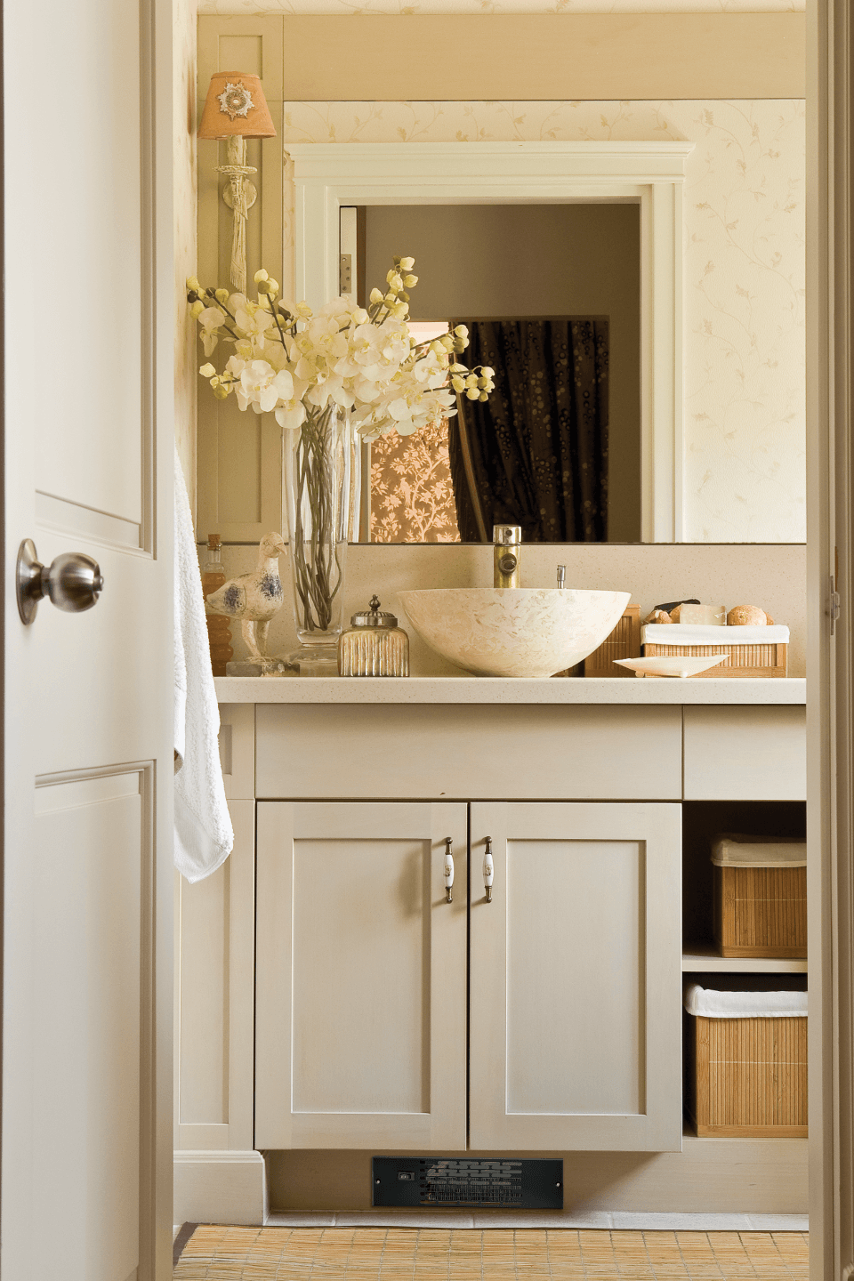 Twin Flo discreetly placed under a bathroom cabinet to keep the space warm